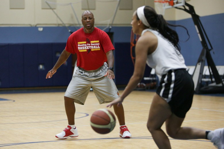 DJ Jones guards his daughter, Mailee, as she works on advancing the ball up court.
