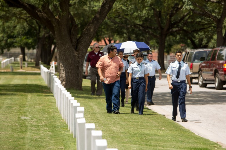 Members of the Air Force ROTC Unit TX 949 of Southside High School arrive to Fort Sam National Cemetery.