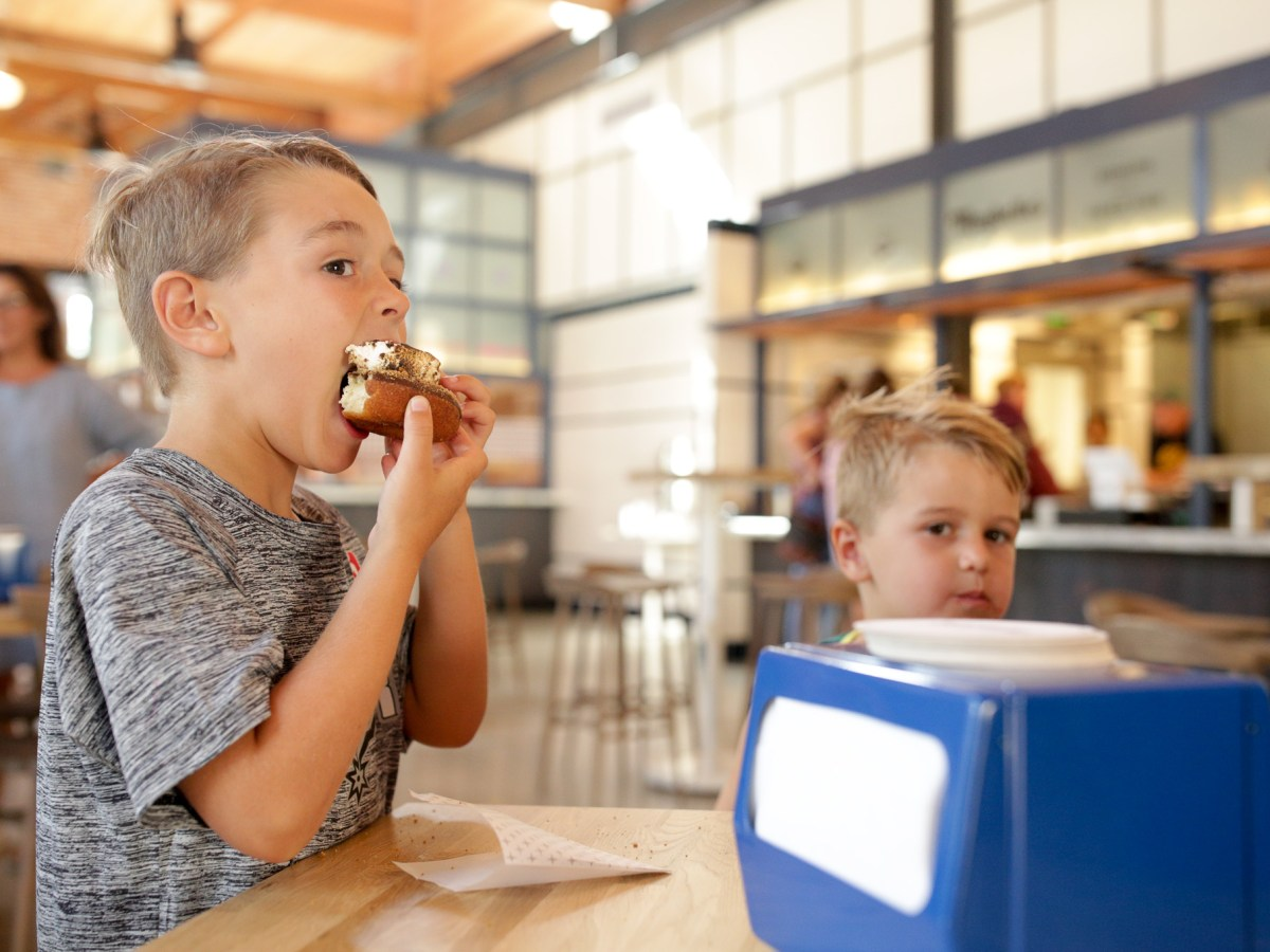 Cooper, 6, eats a donut from Maybelle's Donuts and Fried Pies.