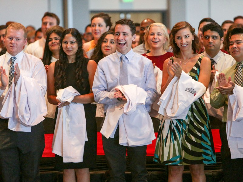 Students applaud during the inaugural White Coat Ceremony for the Doctor of Osteopathic Medicine Program at the University of the Incarnate Word.