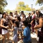 Harlandale High School cheerleaders encourage kids to dance at the Back to School Bash in Hemisfair Park.
