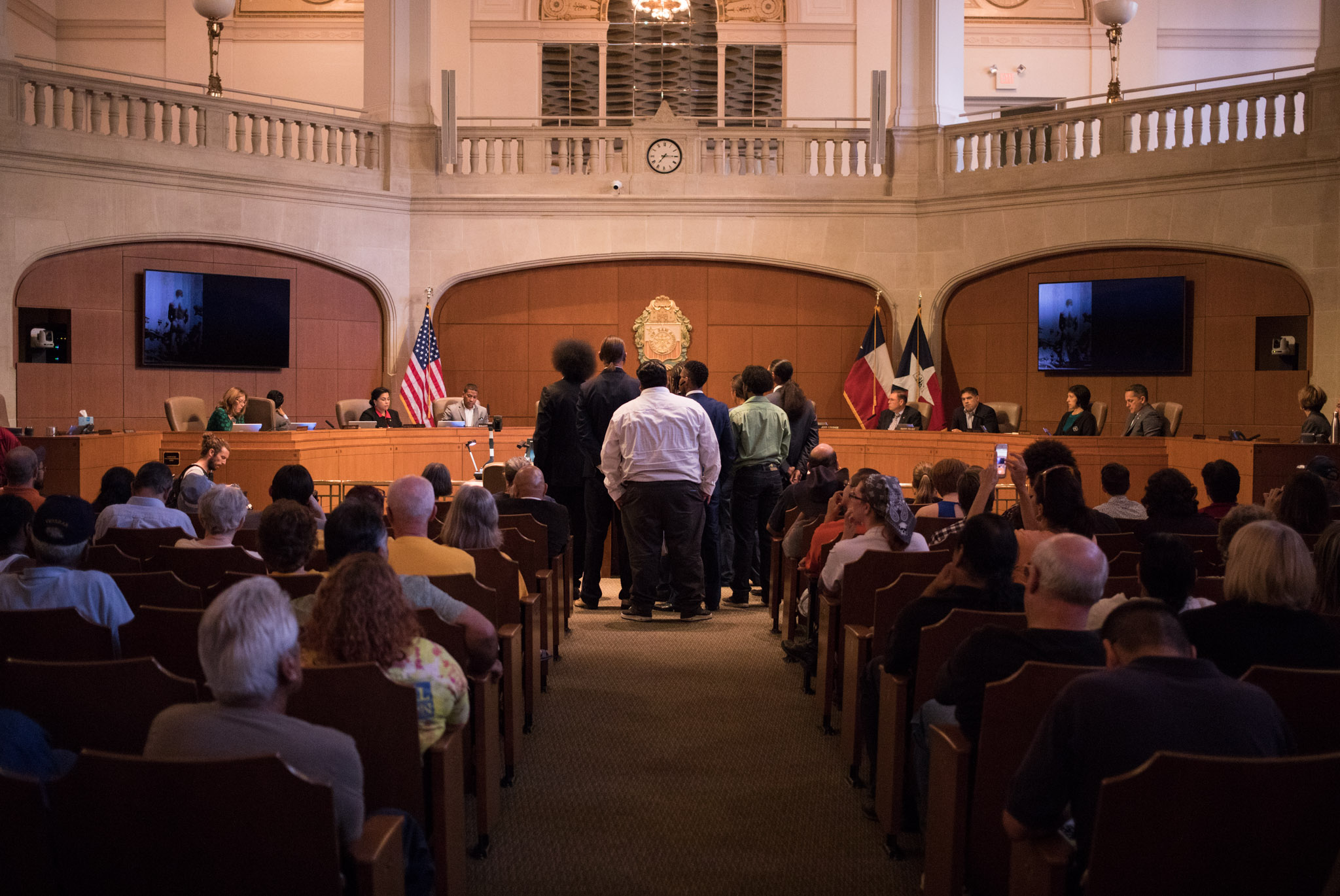 The group Uniting America Through Wisdom speaks at citizens to be heard at Council Chambers in support of the removal of the Confederate monument in Travis Park.