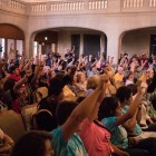 Everyone in the audience in support of the removal of the Confederate monument in Travis Park raises a fist at citizens to be heard at Council Chambers.