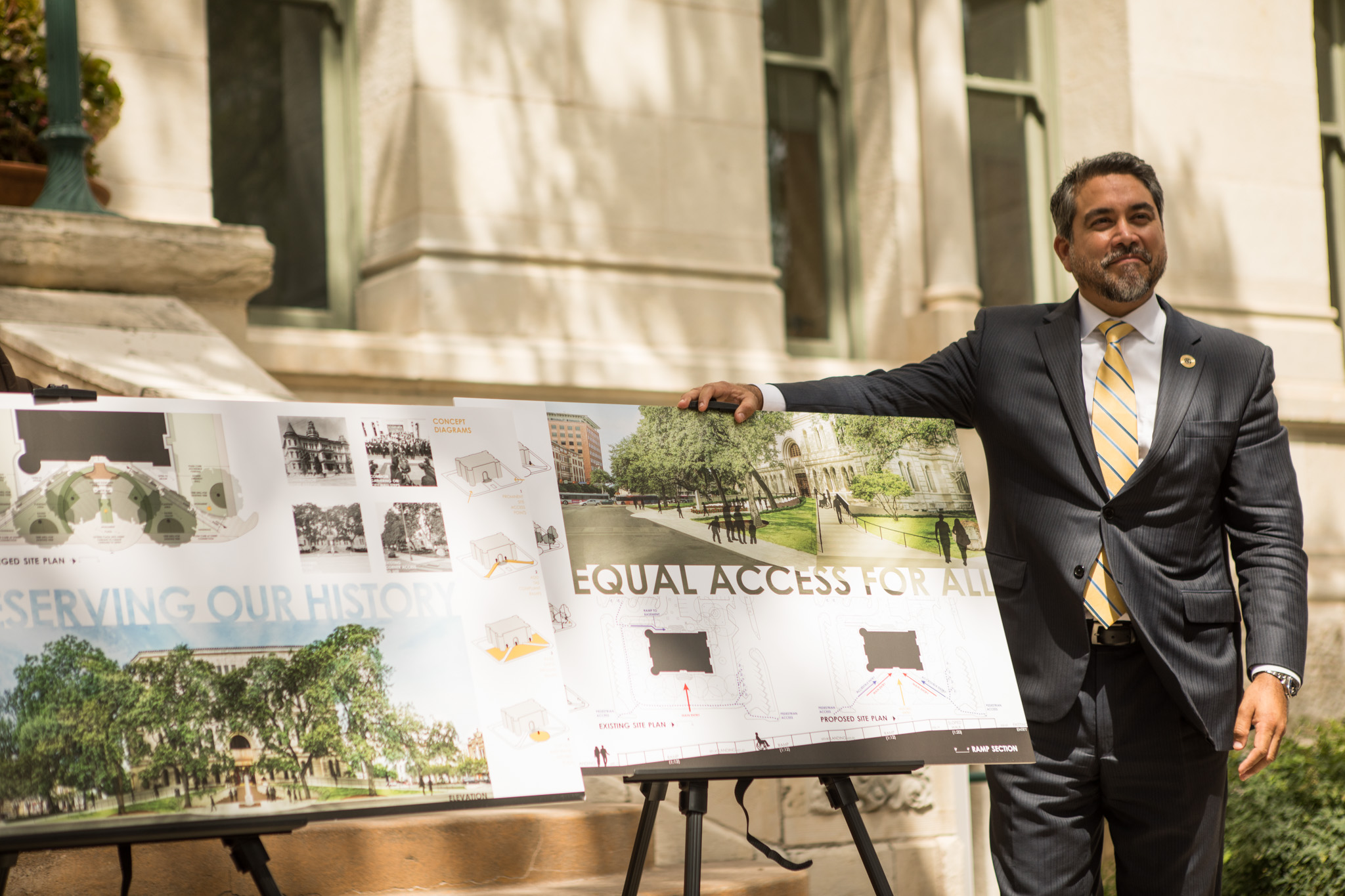 Councilman Roberto Treviño (D1) stands next to the winning design at the announcement of the winner of City Hall For All Design Competition.