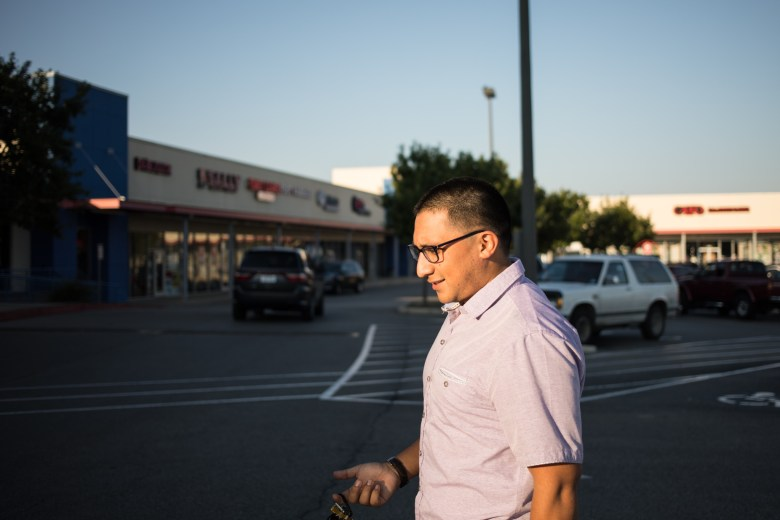 Diego Mancha Dominguez walks into H-E-B employee to get a money order to use for his DACA application. Often in this H-E-B parking lot, Mancha Dominguez sees border patrol police.