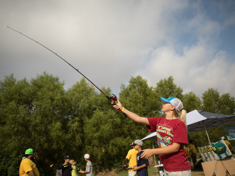 """Bailey, 12, practices """"backyard fishing"""" at Family, Fishing and Friends at Acequia Park."""