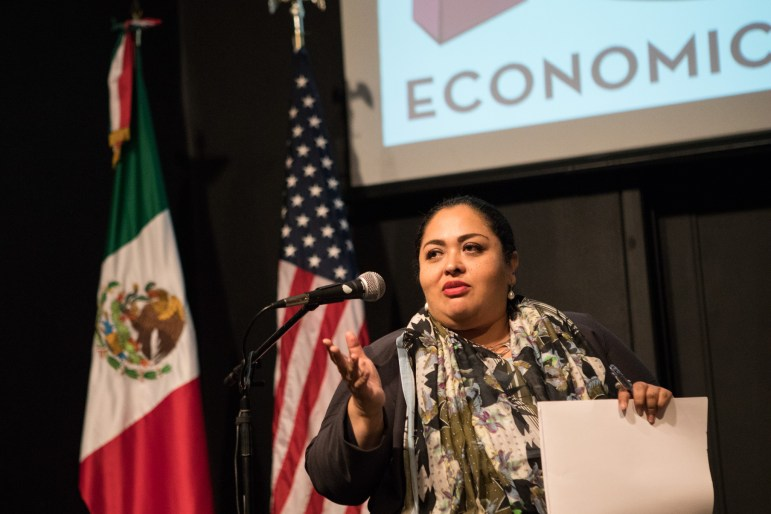 Consul General of Mexico in San Antonio Reyna Torres Mendivil responds to a question at a panel discussion about border issues with Leadership San Antonio Class42 at the Instituto Cultural de Mexico.