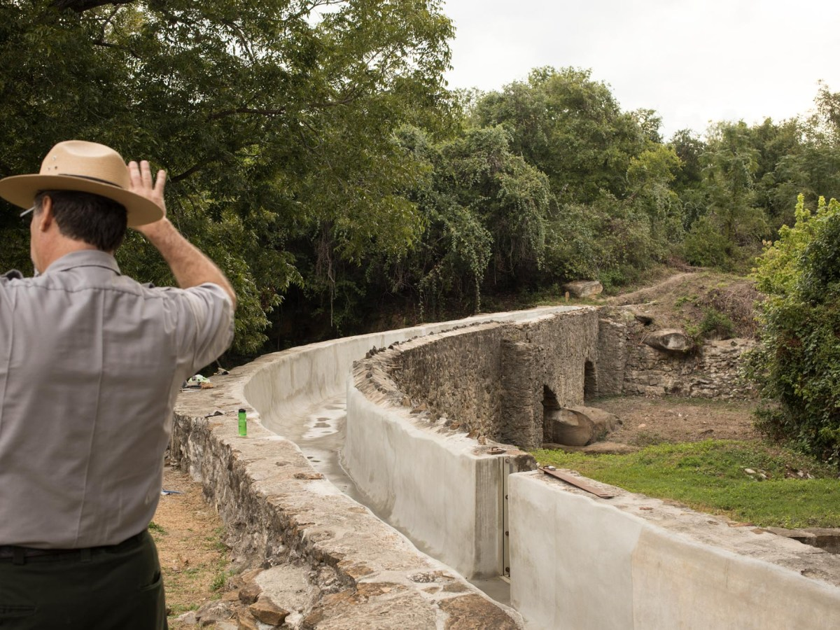 San Antonio Missions National Historical Park Chief of Facilities Management David Vekasy explains the layout of the Espada Aqueduct.