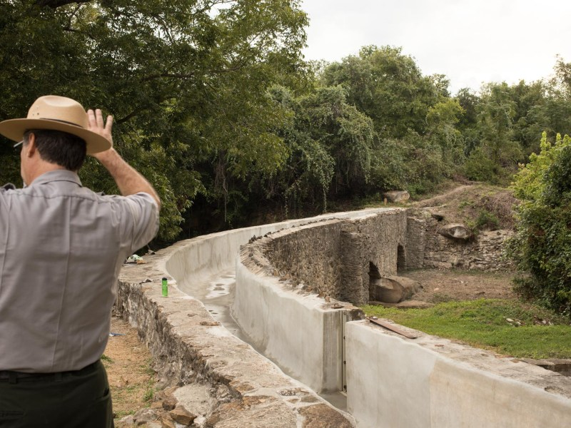 San Antonio Missions National Historical Park Chief of Facilities Management David Vekasy explains the layout of the Espada Aqueduct.