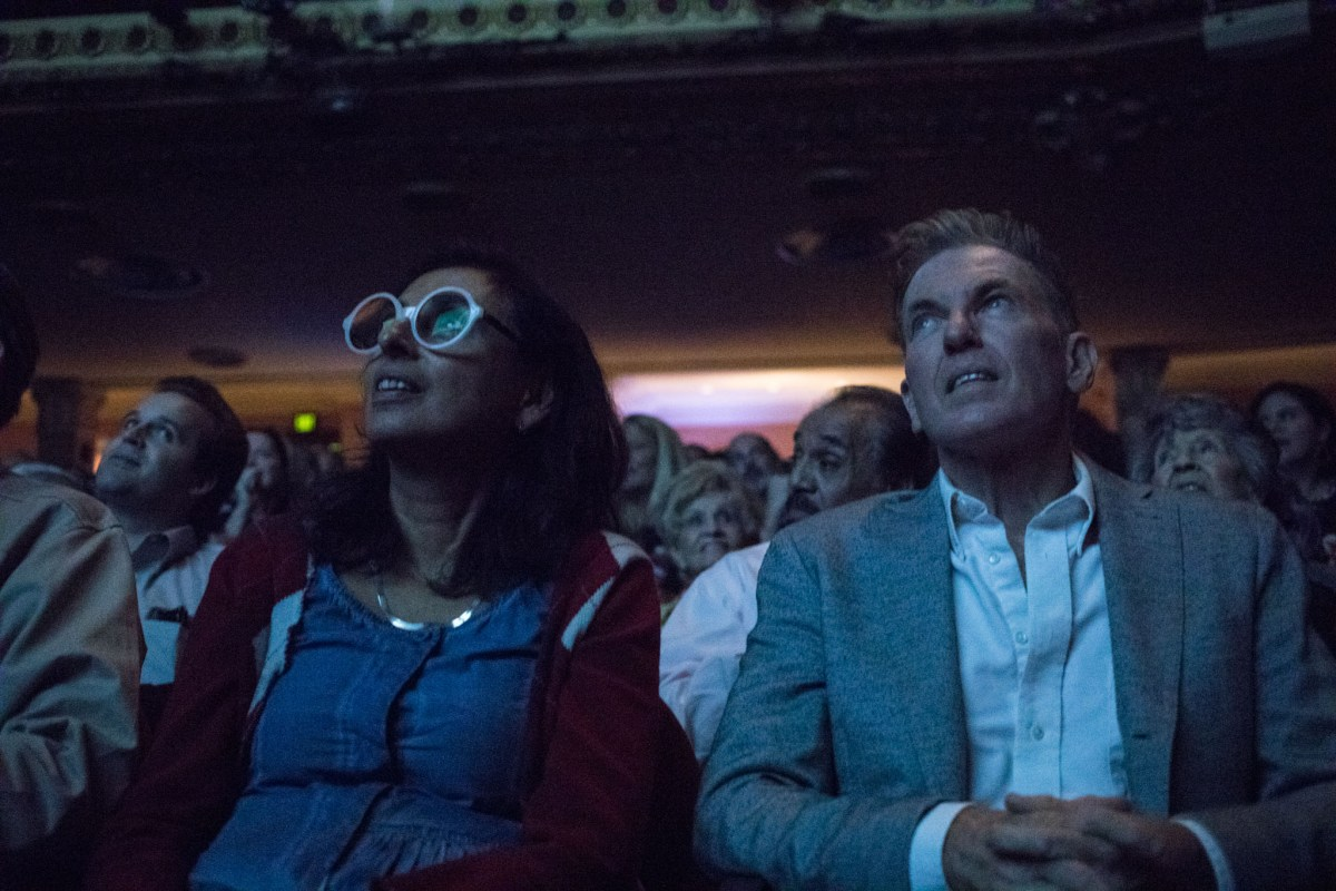 (From left) Patty Ortiz and Bill Sibley listen to a presentation at PechaKucha Vol. 27 at the Charline McCombs Empire Theatre.