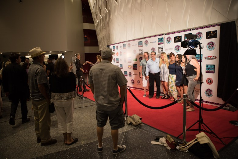 A group poses on the San Antonio Film Festival red carpet at the Tobin Center.