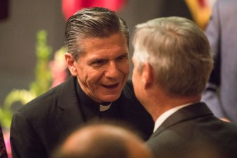 Archbishop Gustavo-García-Siller socializes before the San Antonio-Mexico Friendship Council reception in honor of Ambassador Reyna Torres Mendivil at the Mexican Cultural Institute.