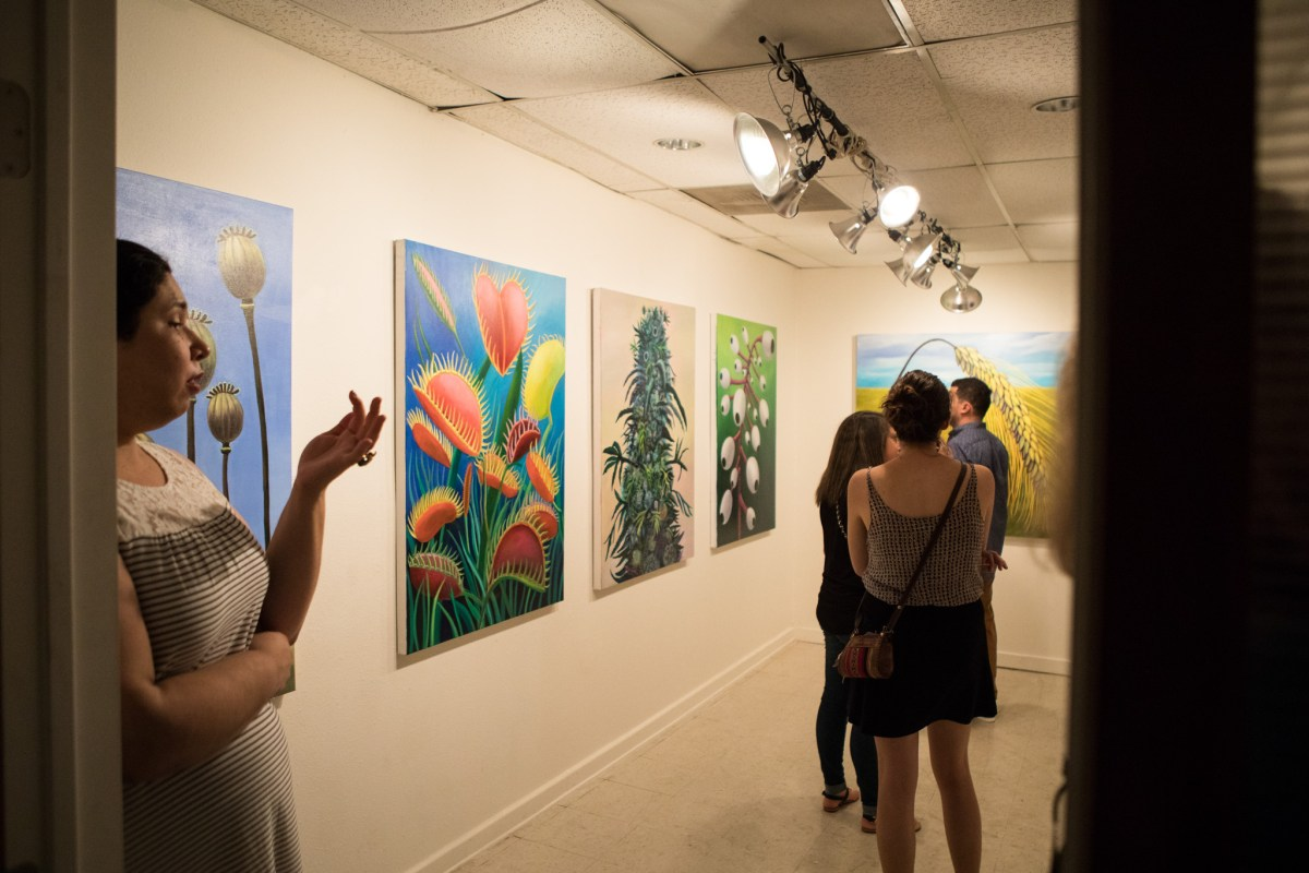 Crowds of people wander the galleries inside 1906 Studio on Second Saturday.