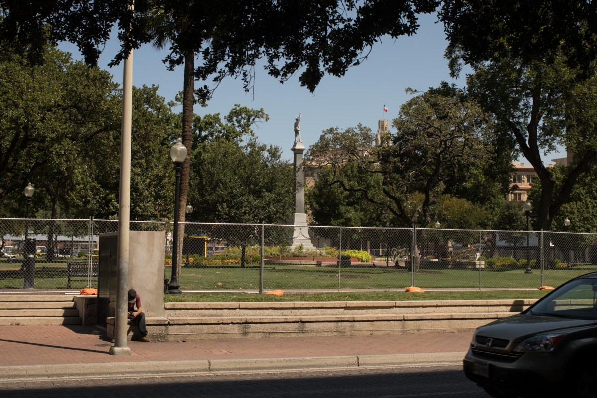 A fence lines the perimeter of Travis Park, where the confederate monument is to be removed.