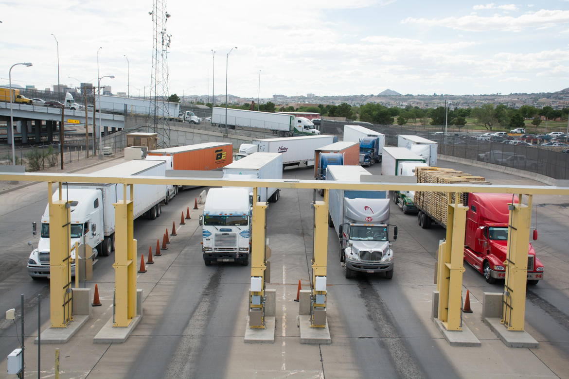 Loaded trucks coming in from Mexico wait in line at the Bridge of the Americans customs station in El Paso, snaking back up the international bridge.