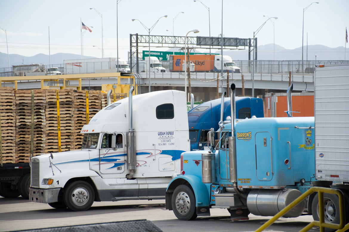 """Loaded trucks coming in from Mexico wait in line at the Bridge of the Americans customs station in El Paso, snaking back up the international bridge. El Paso had 763,868 trucks cross north in 2016 (BTS)"""" Bureau of Transportation Statistics."""