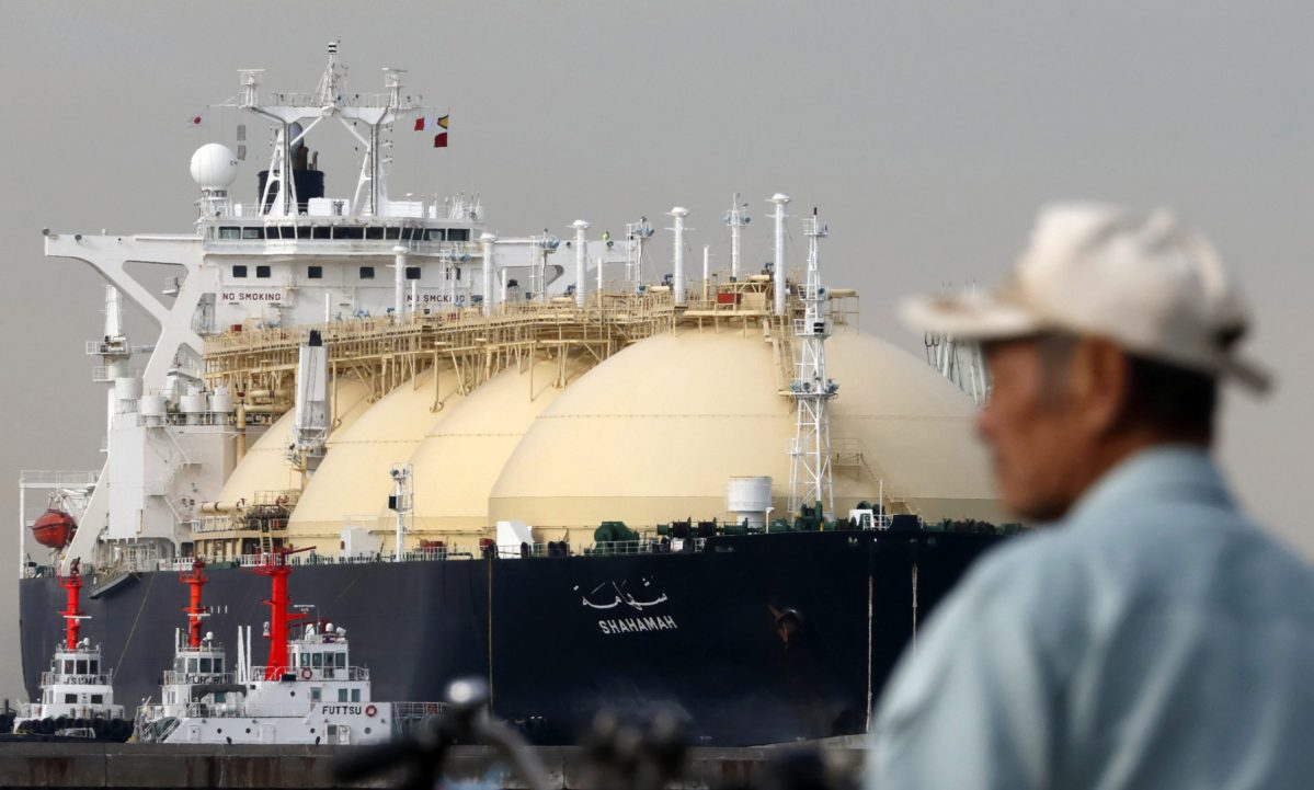 A man stands in front of the Shahamah liquefied natural gas (LNG) tanker berthed at Tokyo Electric Power Co.'s (Tepco) Futtsu gas-fired thermal power plant in Futtsu Chiba Prefecture, Japan, on Thursday, Jan. 21, 2016.