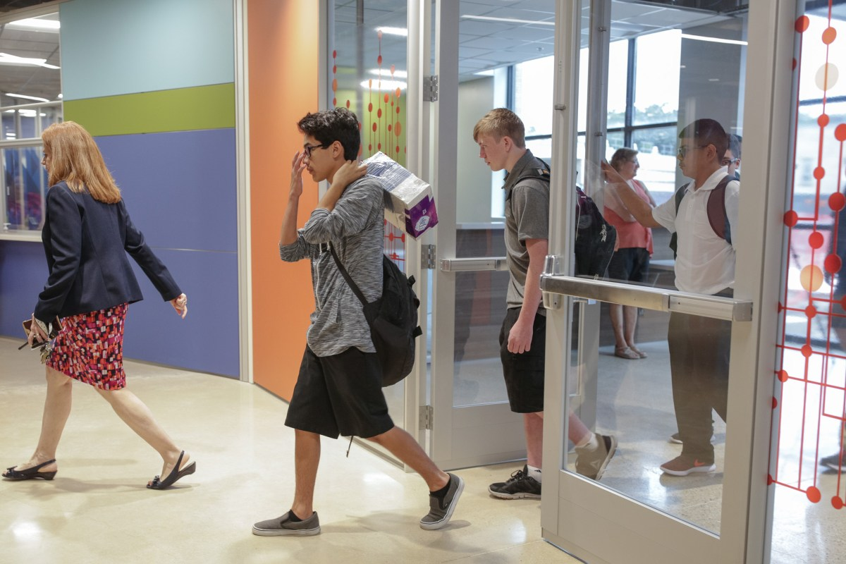 CAST Tech students arrive at school for the first time.