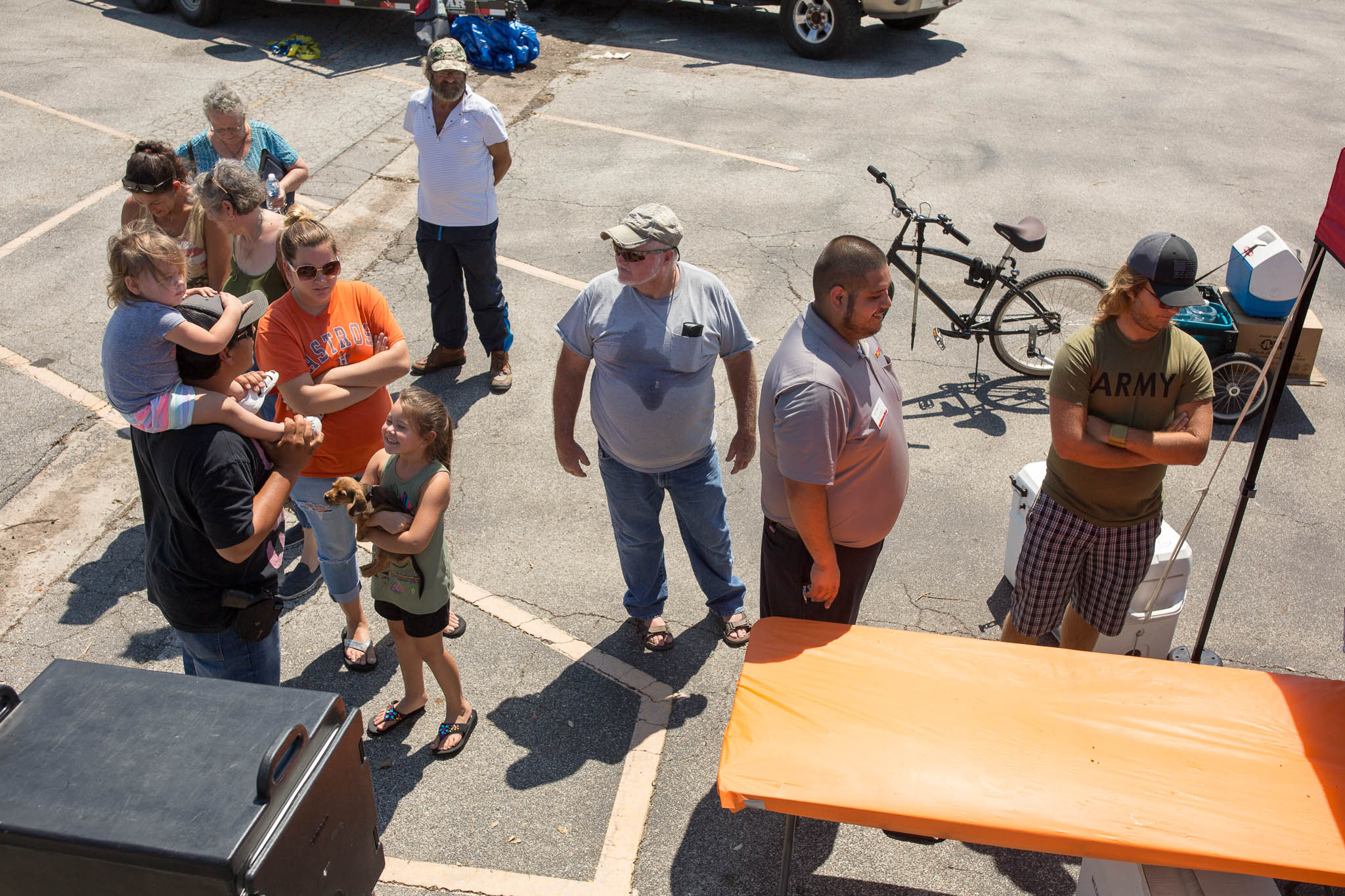 Aransas Pass residents and hurricane victims line up for a free lunch at the Chow Train.