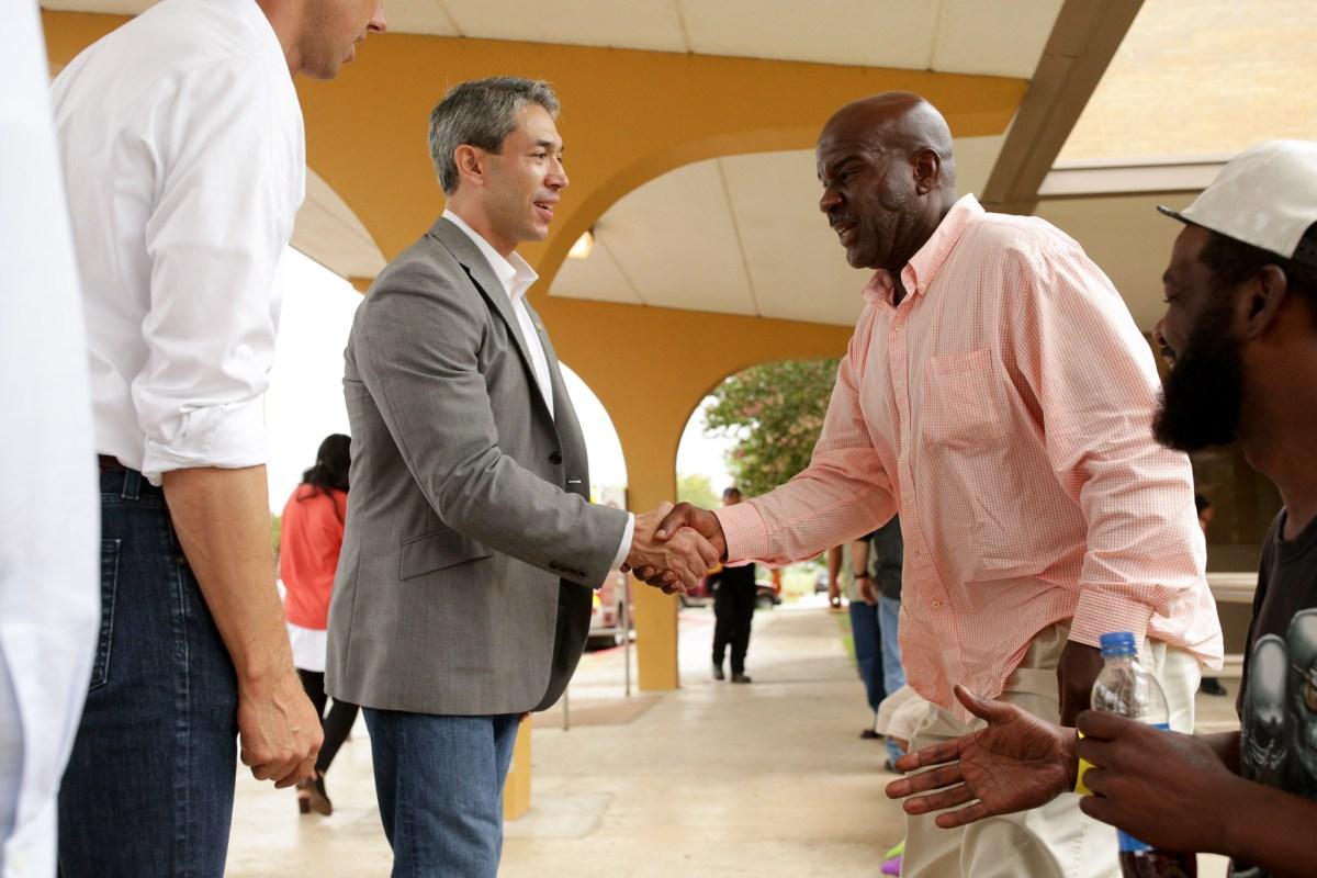 Mayor Nirenberg greets Corpus Christi evacuees Crayton Kelly and Steven Miles outside a shelter setup at Kazen Middle School.