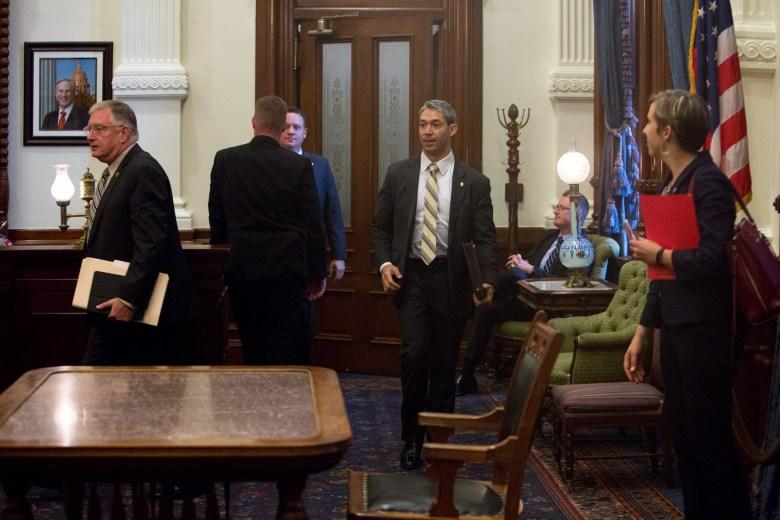 San Antonio Mayor Ron Nirenberg and Garland Mayor Douglas Athas leave the office of Texas Governor Greg Abbott following a meeting.