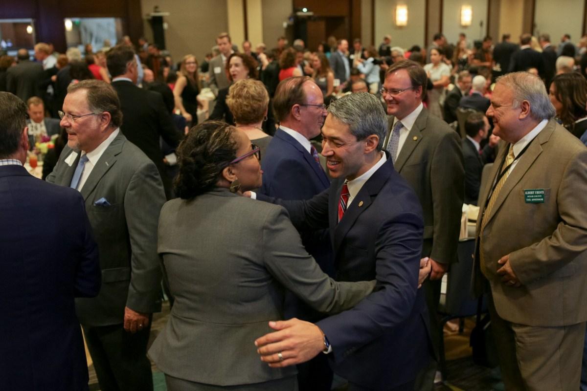 Mayor Ron Nirenberg greets a guest at the San Antonio North Chamber Luncheon at the Hyatt Regency Riverwalk.