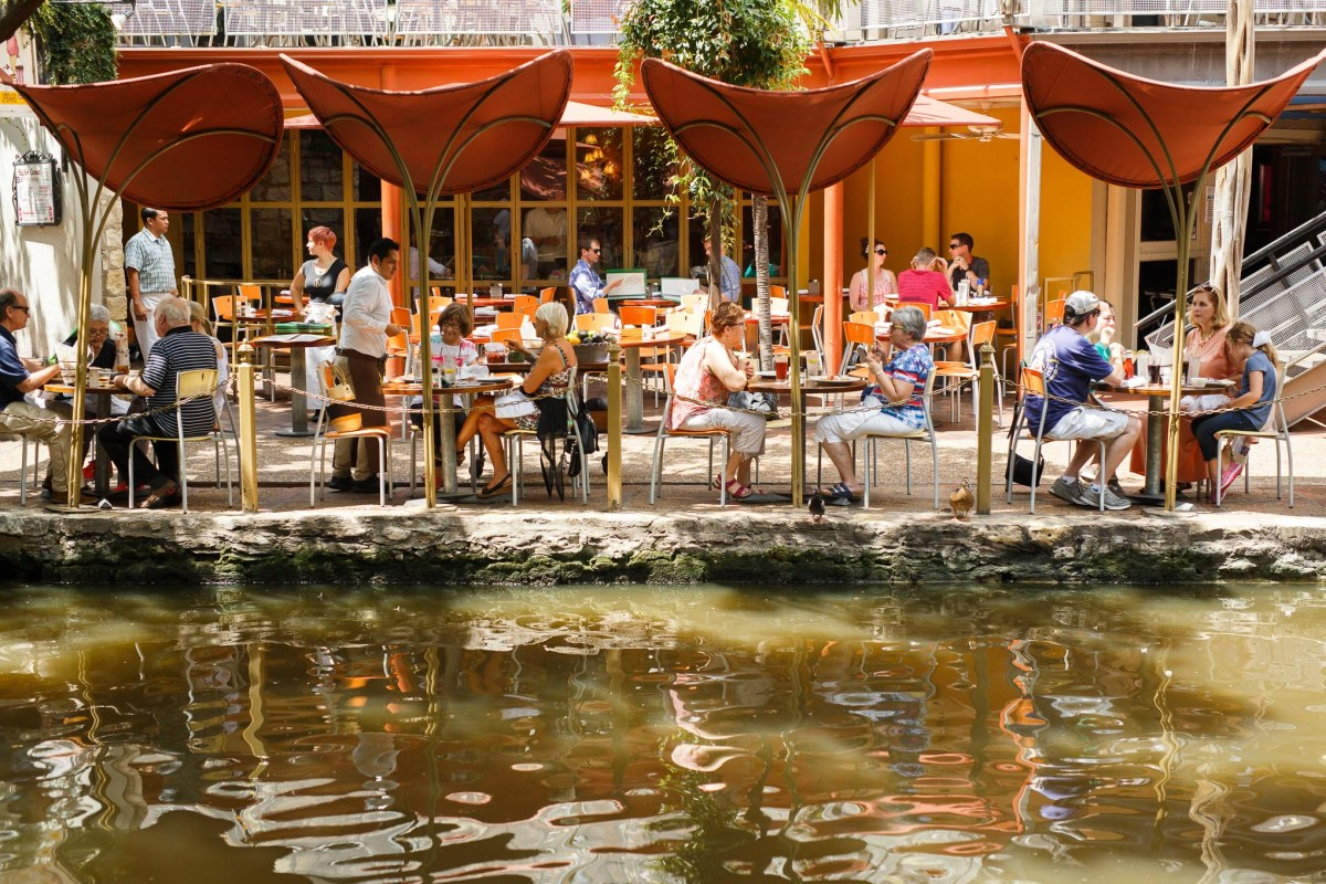 Lunchtime guests eat at Boudro's Texas Bistro along the riverwalk.