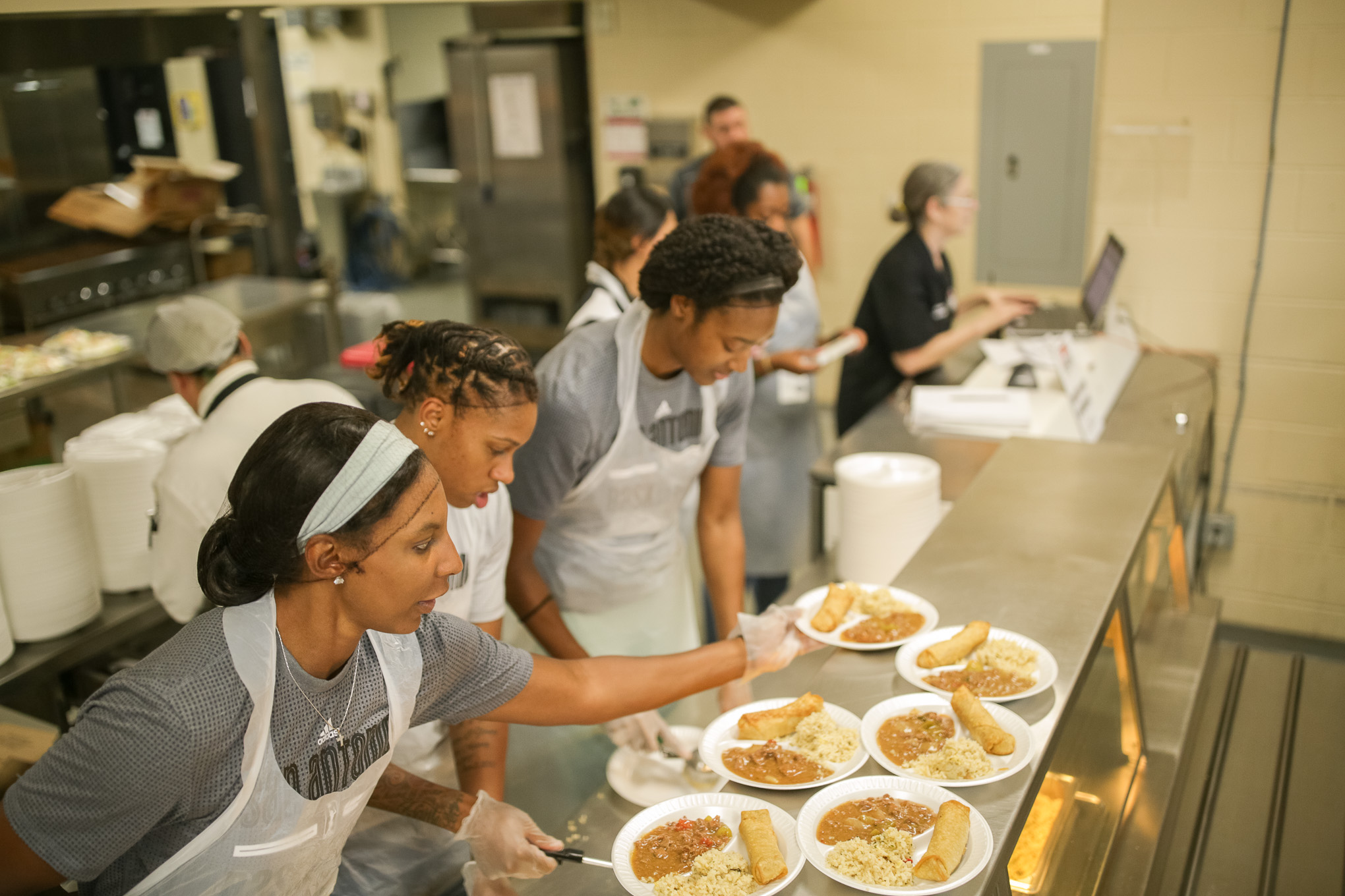 Stars players assemble dinner plates prepping meals for Haven for Hope residents.