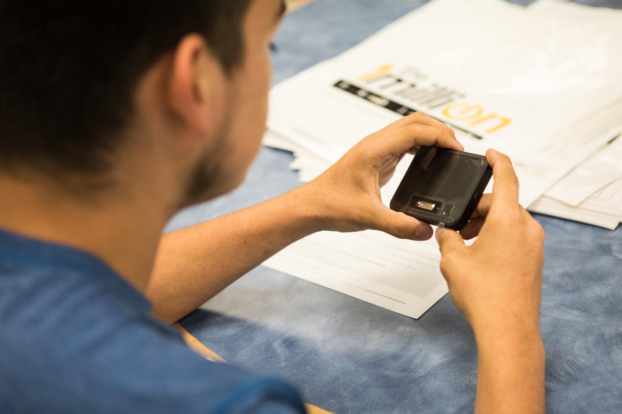 Giovanni Almonte inspects his new personal hotspot, given to him as part of the 1 Million Project.