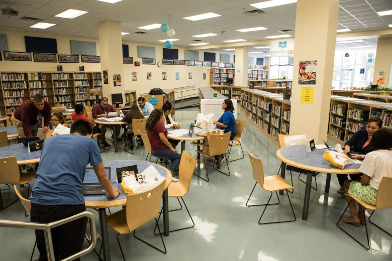 Students gather in the South San High School library after receiving a personal hotspot as part of the 1 Million Project.
