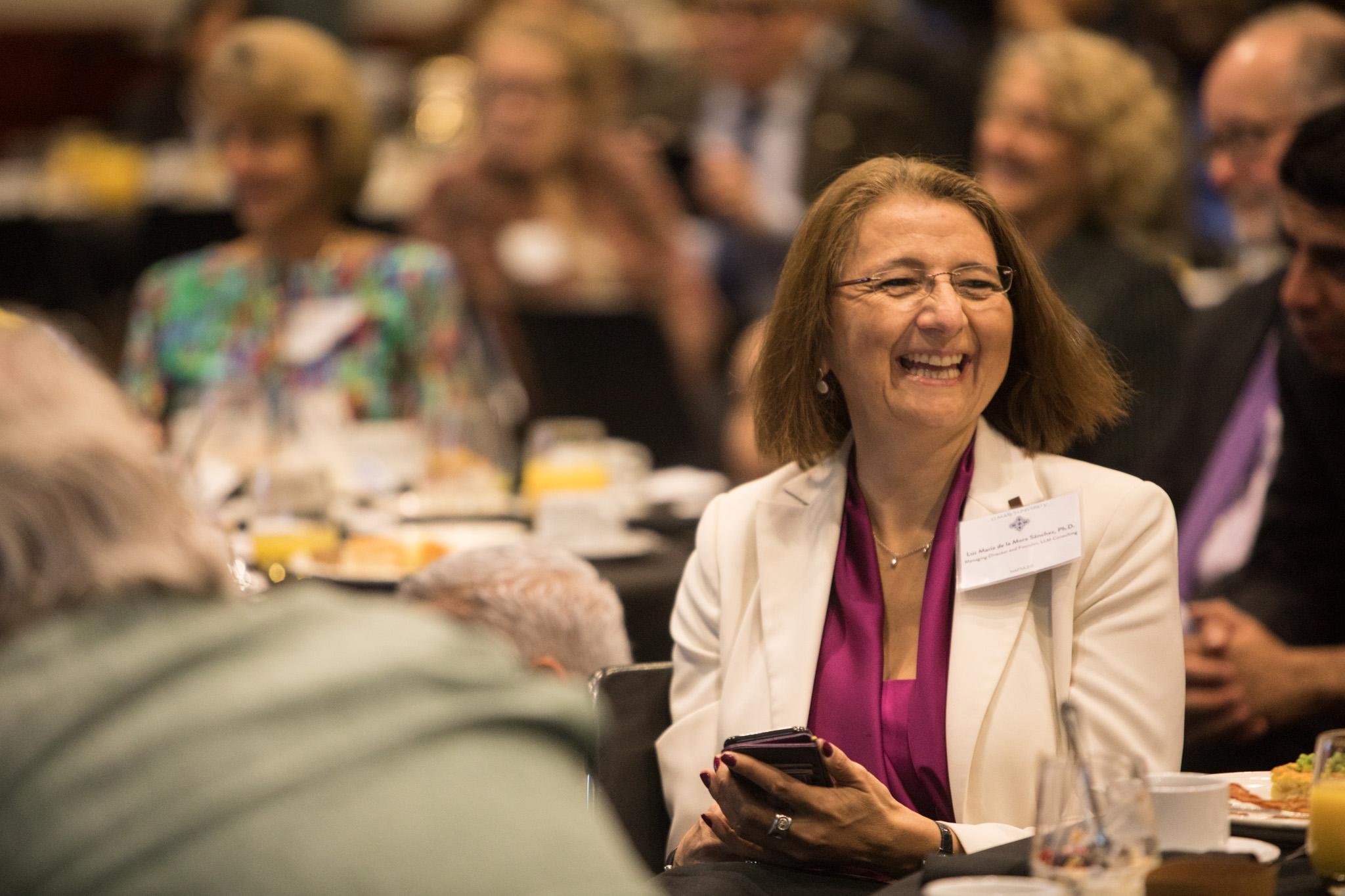 Luz María De La Mora Sánchez laughs during a panel discussion at NAFTA 2.0: The Future of North American Trade at St. Mary's University.