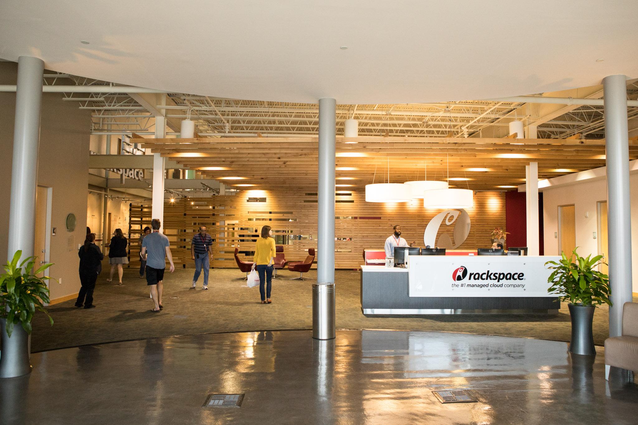 Employees of Rackspace walk through the main lobby.