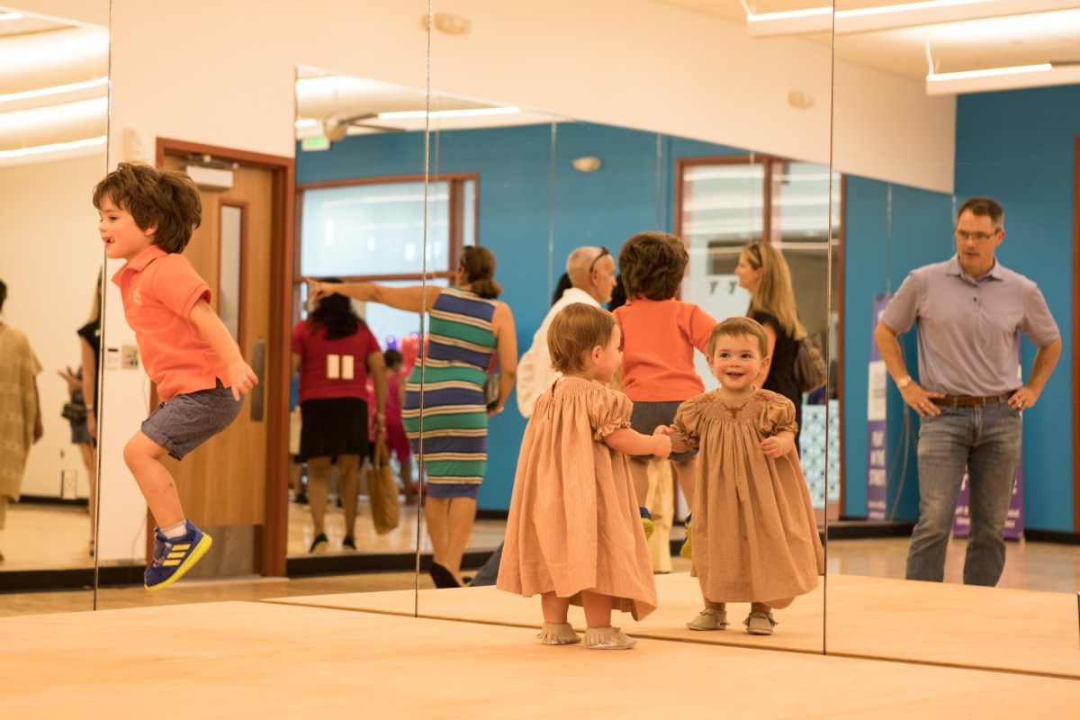 (From left) Beau Smith and Mimi Smith jump around and play in the new group exercise studio of the Harvey E. Najim Family YMCA.