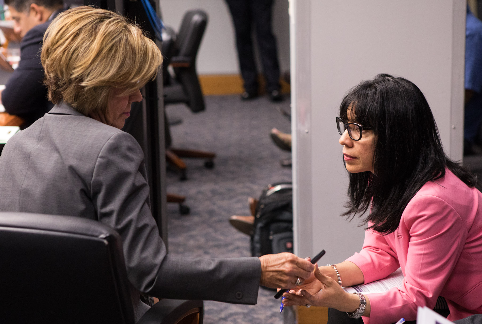 City Manager Sheryl Sculley (left) speaks with Assistant City Manager María Villagómez during the budget discussion on Wednesday.