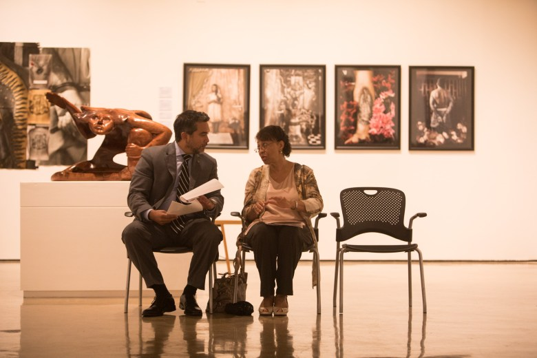 (From left) Councilman Roberto Treviño (D1) and Freda Facey chat before the Third Annual Distinction in the Arts honoree announcement at the Centro de Artes Gallery.