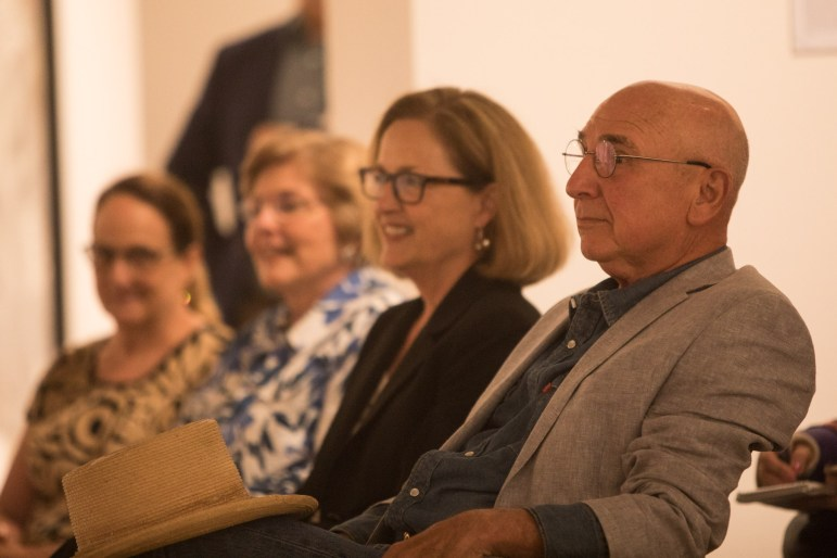 Distinction in the Arts honorees sit in the front row at the Third Annual Distinction in the Arts honoree announcement at the Centro de Artes Gallery.