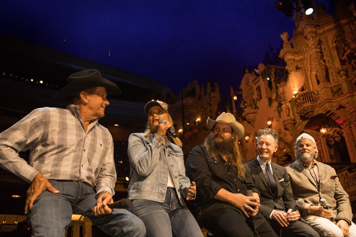 """(From left) George Strait, Miranda Lambert, Chris Stapleton, Lyle Lovett, and Robert Earl Keen speak at a press conference about the telethon """"Hand in Hand: A Benefit for Hurricane Harvey Relief"""" at the Majestic Theatre."""