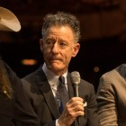 """Lyle Lovett speaks at a press conference about the telethon """"Hand in Hand: A Benefit for Hurricane Harvey Relief"""" at the Majestic Theatre."""