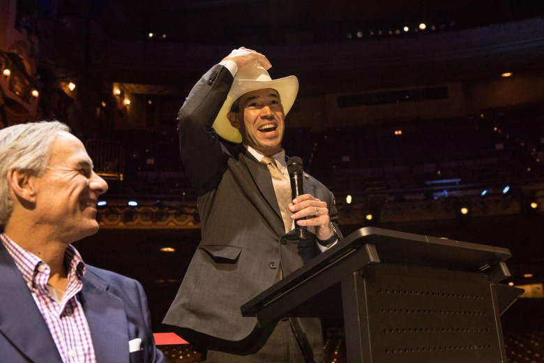Mayor Ron Nirenberg (right) jokes that he wants his hat signed by George Strait at a press conference before the concert at the Majestic Theatre.