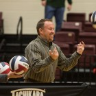 Ronald Reagan High School Volleyball Coach Mike Carter helps his team warm up before their match against Roosevelt High School.