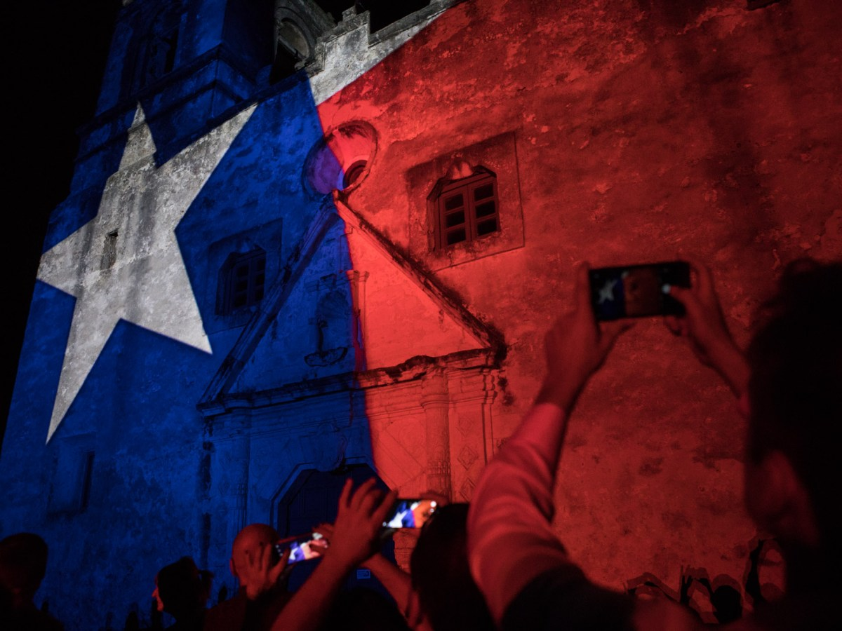 Mission Concepción is lit up like the Texas flag during Restored By Light.