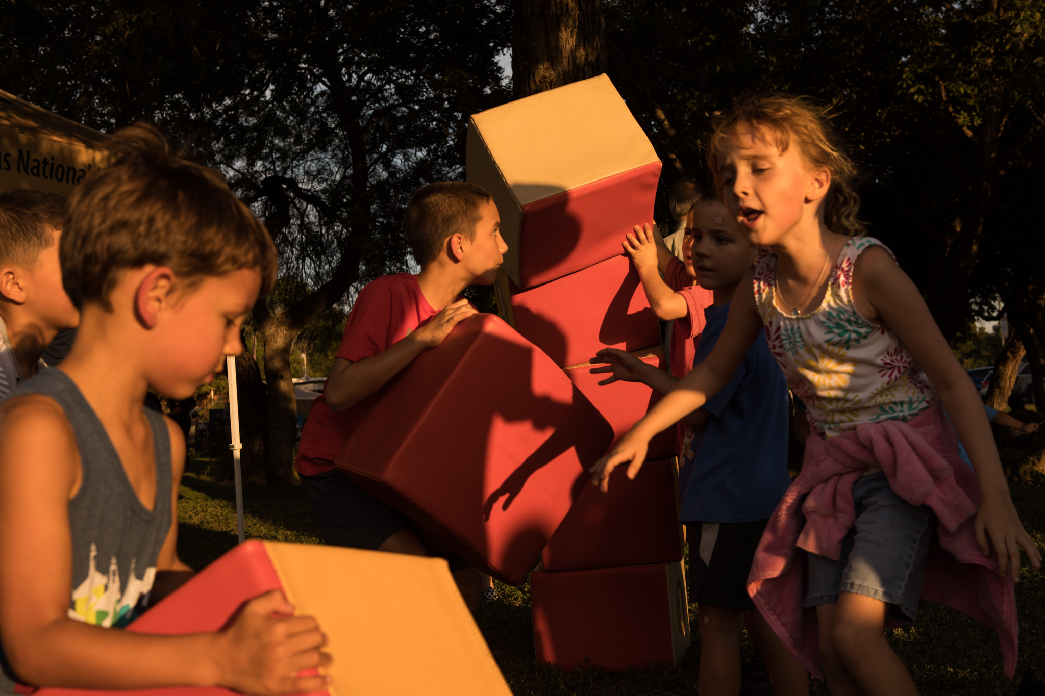 A group of children play with large blocks to learn the importance of the architectural design of the keystone arch at Restored by Light.
