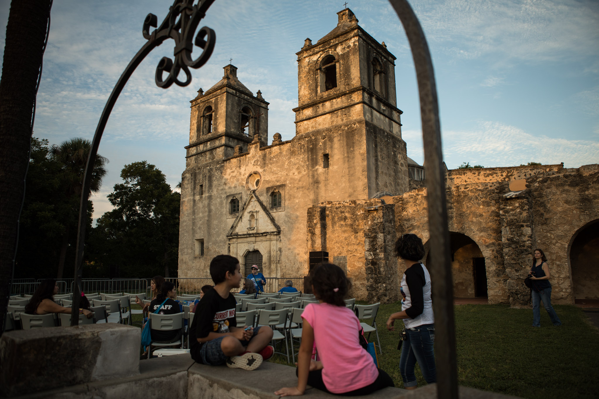 A group of children admire Mission Concepción before the sun sets and Restored by Light begins.