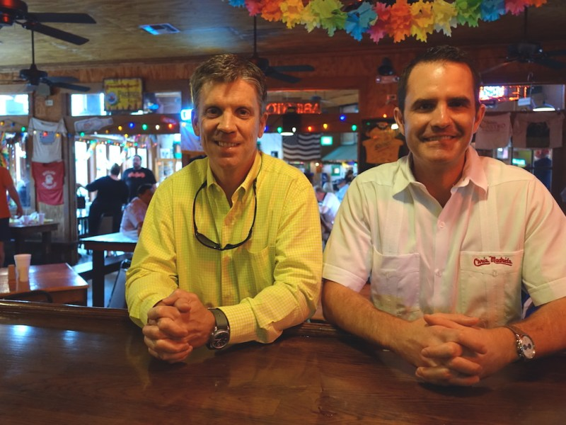 Chris Madrid's owner Richard Peacock (left) and outgoing Director of Operations Bryce Waller stand at Jimmy's Bar inside the iconic burger joint.