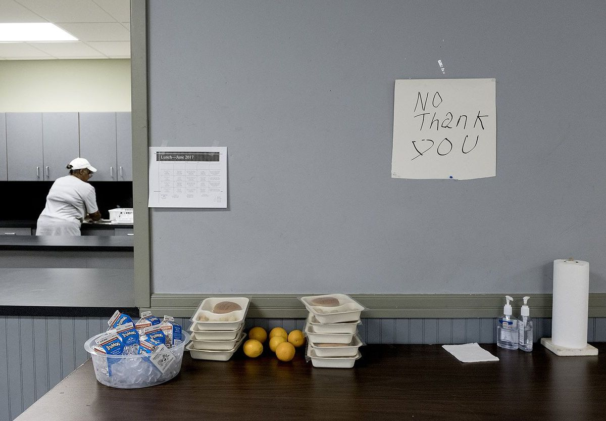 "Kids leave food they don't want on a ""No Thank You"" table so others can pick it up at a community center in the East Texas community of Reklaw."