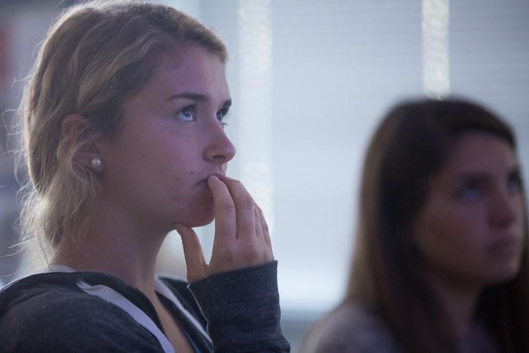 Katie Detner, 16, observes images of the World Trade Center attack on Sept. 11, 2001.