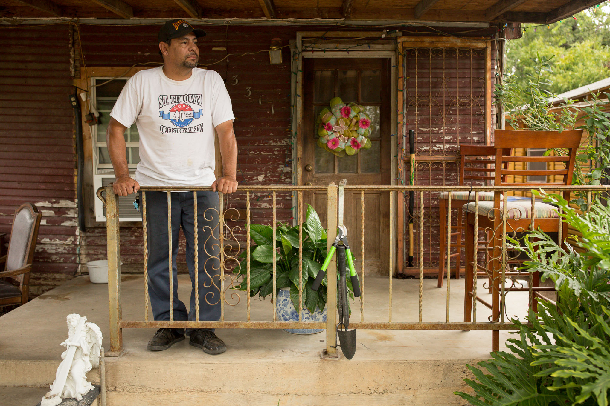 Rodrigo Rendon stands in front of his home in the Westside of San Antonio.