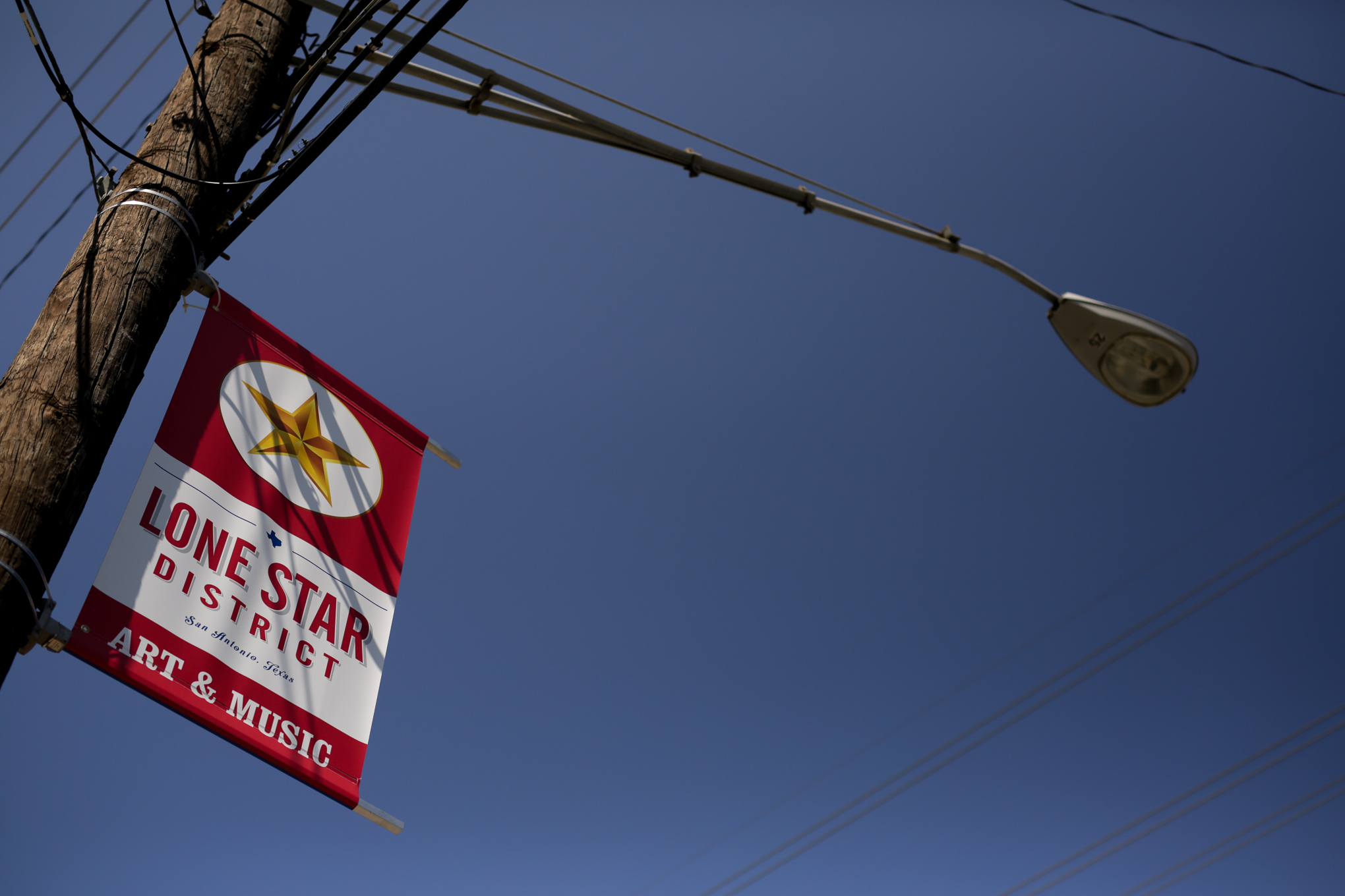 Lone Star District banners fly high above Probandt Street outside of La Tuna.