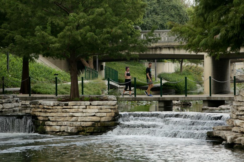 Joggers along the San Antonio River finish their workout near the Pearl along the Museum Reach.