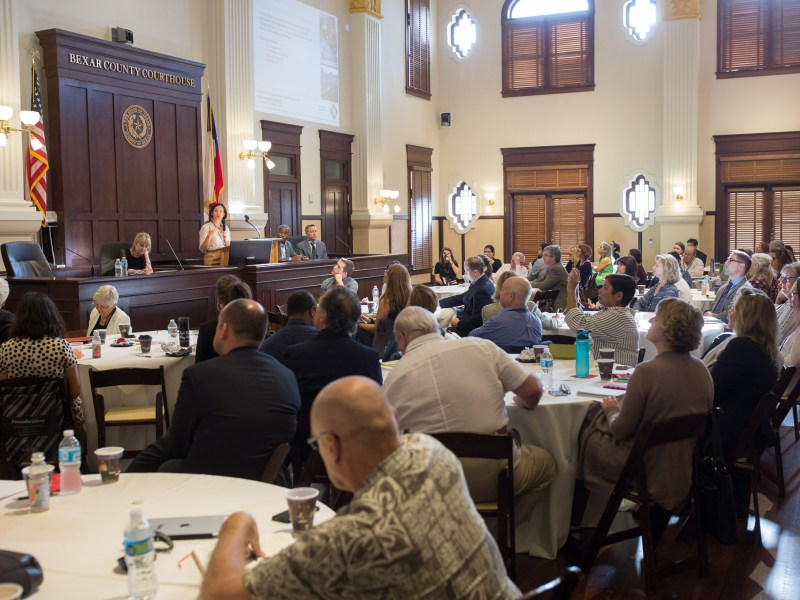 Dr. A. Ege Yildirim speaks to attendees of the World Heritage Symposium at the Bexar County Courthouse.